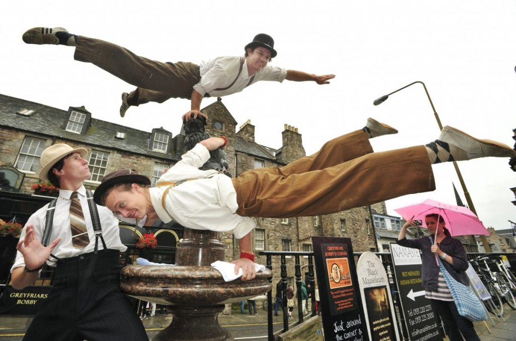 Street performers at Edinburgh Fringe making impression.